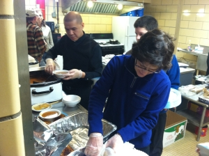 Father Joseph Sia and Linda DePuydt volunteered to help serve a meal for Loaves & Fishes on Feb. 23 at MCSA.