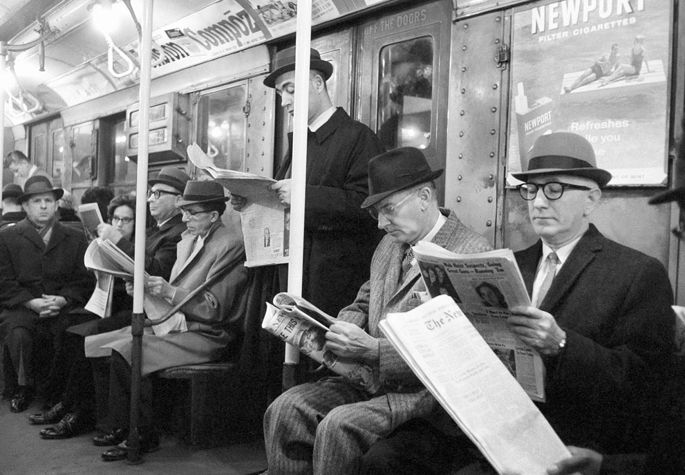 Riders read their morning newspapers on New York's subway en route to work, on April 1, 1963 after the end of the city's 114-day newspaper strike. (AP Photo/Jacob Harris)