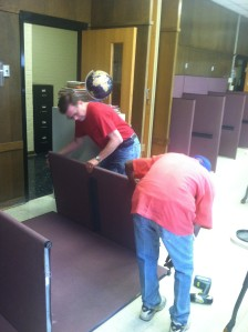 Tom Curry, left, MCSA building manager, works with resident Michael Vivians to empty out the Learning Center at MCSA.