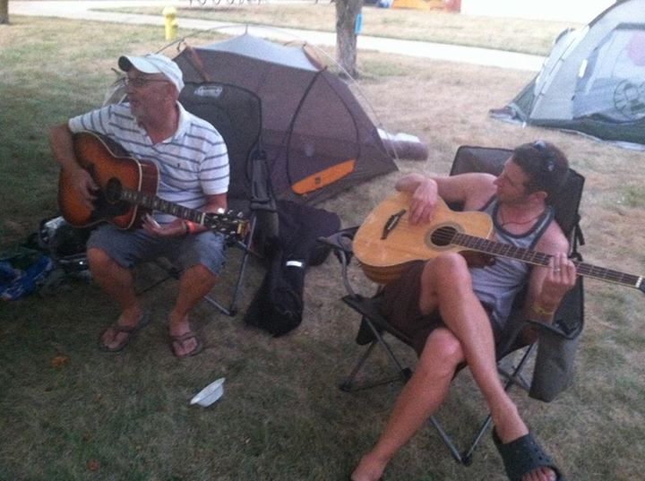 """Steve Smartt of Nashville, left, and his son, Stuart Smartt of Atlanta serenaded other members of the Morrison Group in Webster City when RAGBRAI stopped there in 2012 with """"Give Me One More Sip of That Worry Be Gone."""""""