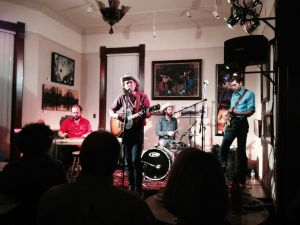 Cale Tyson peforming at River's Edge Gallery in Muscatine on March 29.