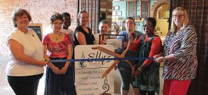 In 2013,  Elly's Tea & Coffee was named as a Blue Zones Restaurant. Pictured are, from left: Diana Broderson, Julie Edmonds, Jackie Scroggins, Molly McGuire, Shea Everhart, Angela Collins, Elly Lloyd, Jane Daufeldt. The Blue Zones Restaurant Pledge was created to help restaurants do simple things to help their guests make healthier choices and eat fewer calories, without cutting into the bottom line. Muscatine Journal photo